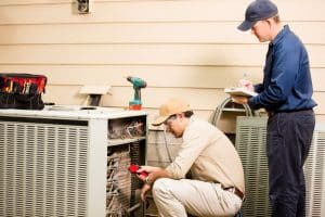 technicians-evaluate-air-conditioning-system